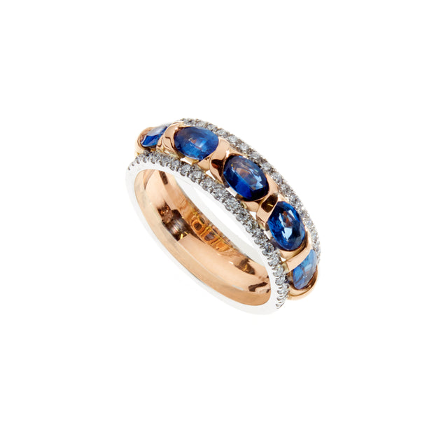 18ct white and rose gold ring. Set with five oval blue sapphires and 0.52ct of pave set diamonds along each edge.