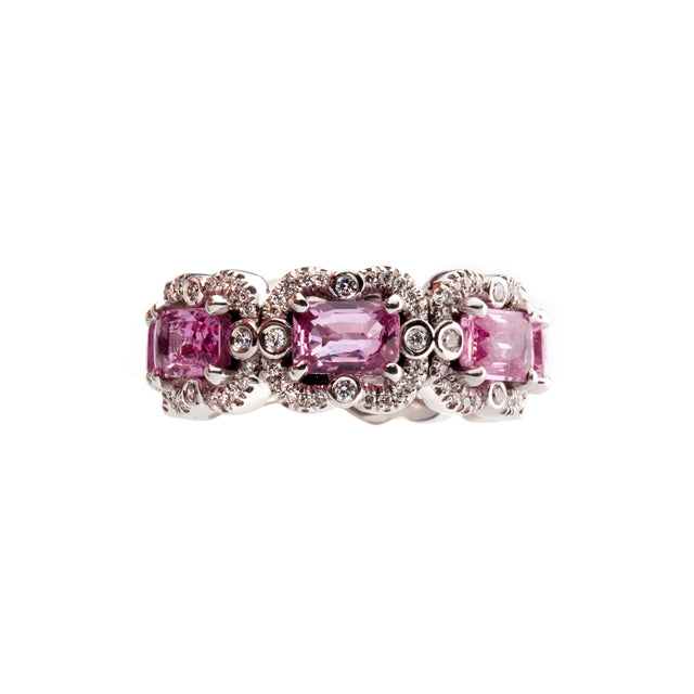 Emerald cut octagon pink sapphire eternity ring surrounded by round cut brilliant diamonds. Part of the Ballerina collection.