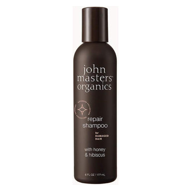 Bottle of John Masters Organics Repair Shampoo for Damaged Hair with Honey & Hibiscus 6 Ounces