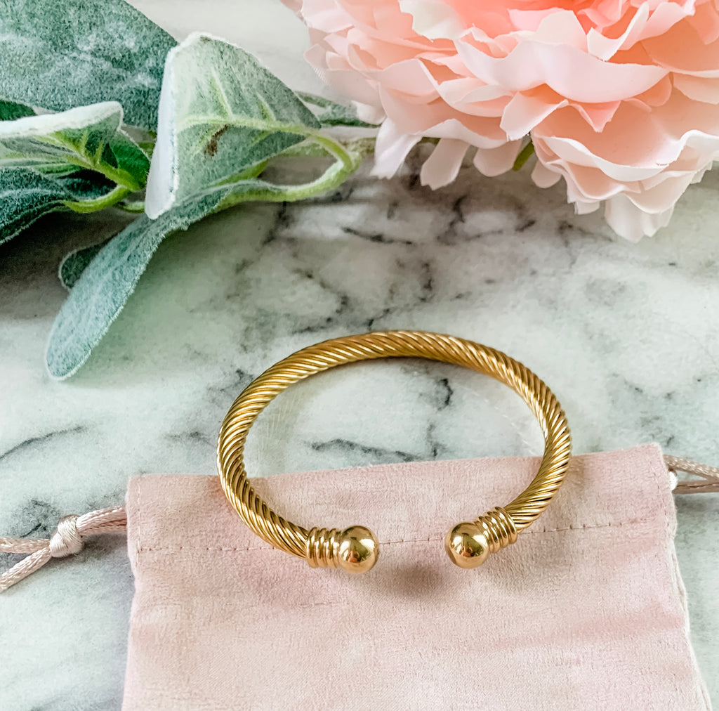 Exclusive Philanthropic Gold Cuff Bracelet