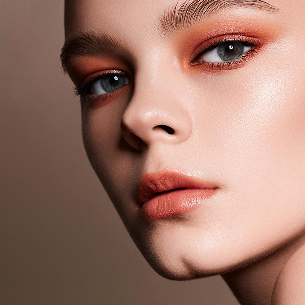 The Radiant Gray Contacts enlarge and deepen eyes of model