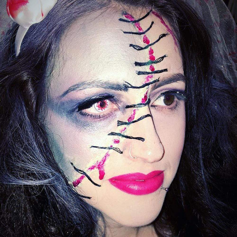 Model are wearing Blood Splat Cosplay Contacts