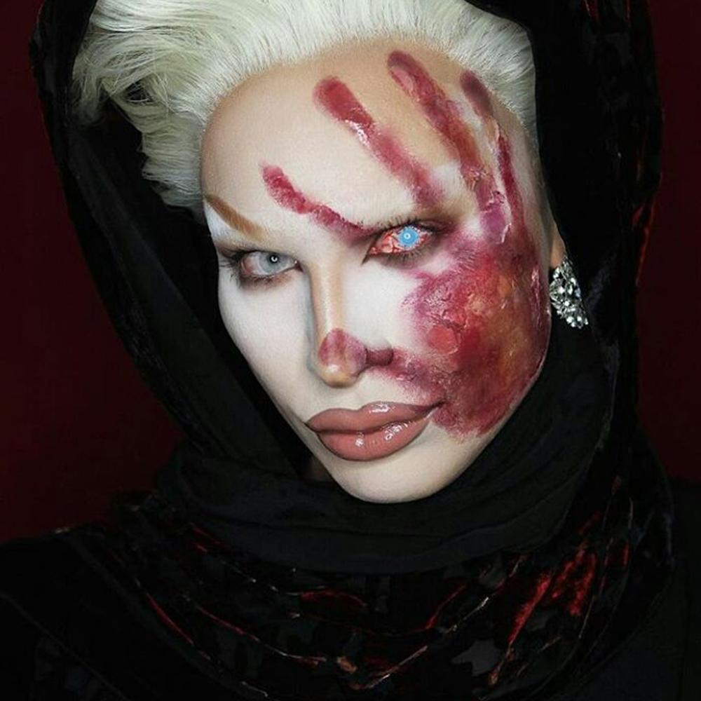 Model are wearing Bloodshot Infected Zombie Sclera Contacts