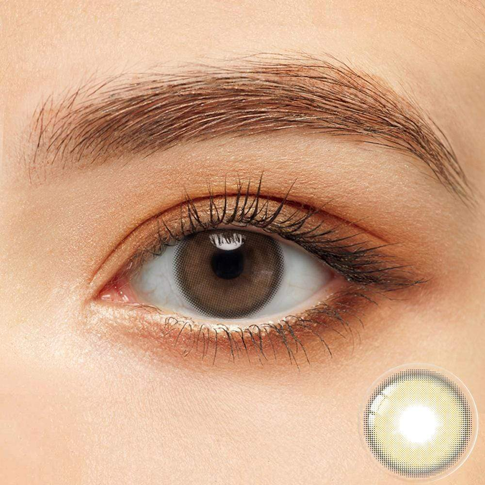 Amber brown colored contacts in the dark eyes