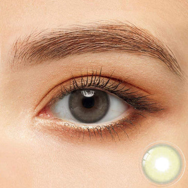 Vivid green colored contacts in the dark eyes