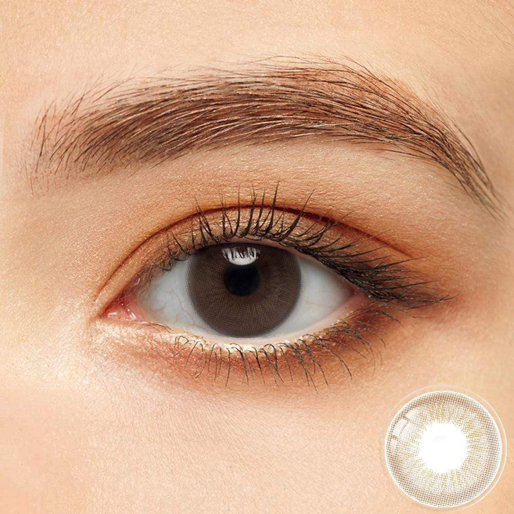 Honey brown colored contacts in the dark eyes