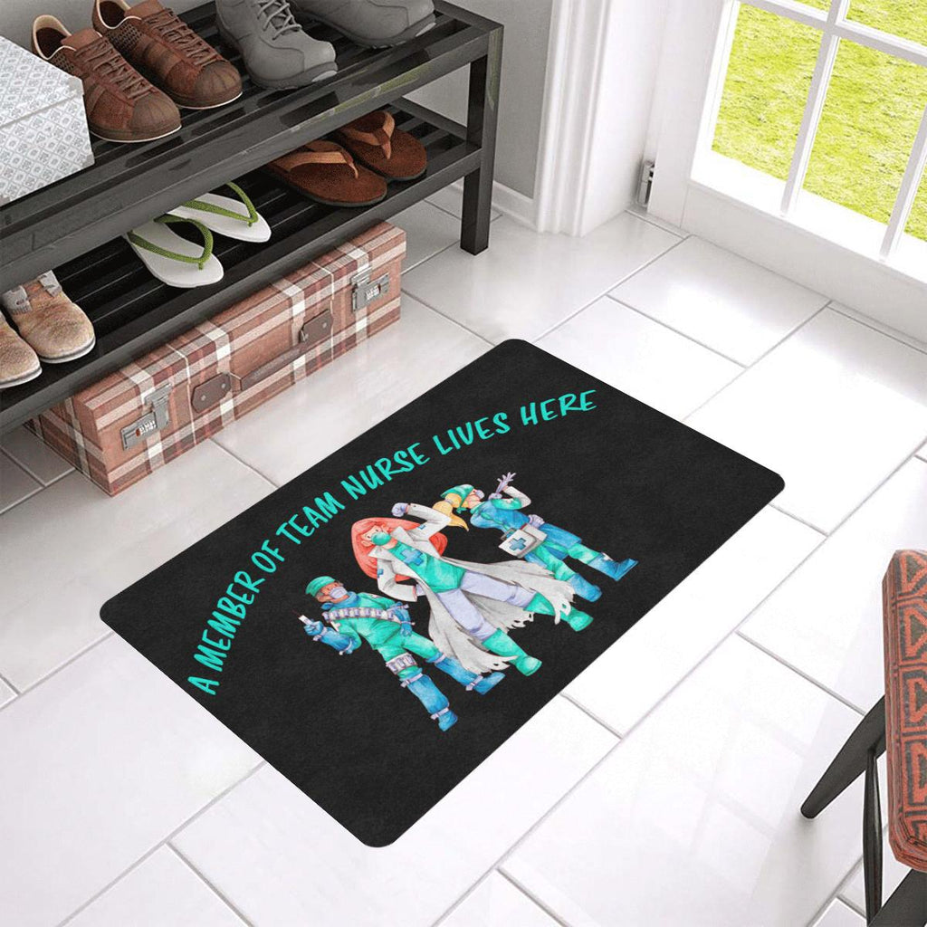 "A member of team nurse lives here, Doormat Doormat 24""x16""(Rubber) Black"