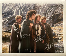 Load image into Gallery viewer, Elijah Wood, Sean Astin, Billy Boyd and Dominic Monaghan - Cast Signed Lord of the Rings Image #1 (8x10, 11x14, 16x20)