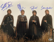 Load image into Gallery viewer, Elijah Wood, Sean Astin, Billy Boyd and Dominic Monaghan - Cast Signed Lord of the Rings Image #2 (8x10, 11x14, 16x20)
