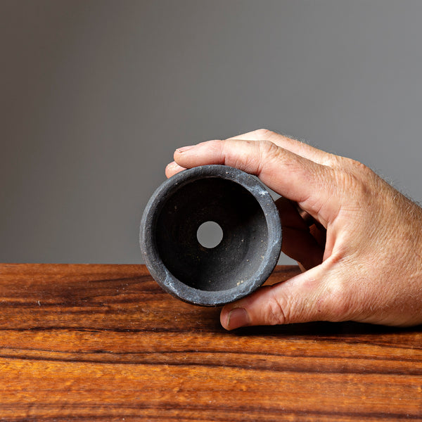 photo of Dark Clay Japanese Round Pot, held  and inside shown