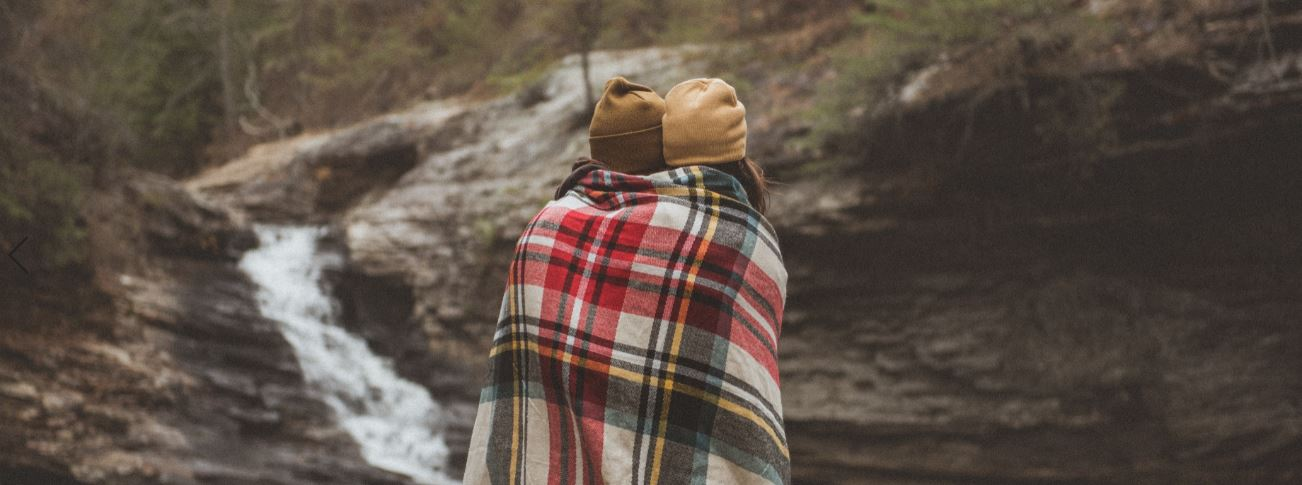Couple wrapped in plaid
