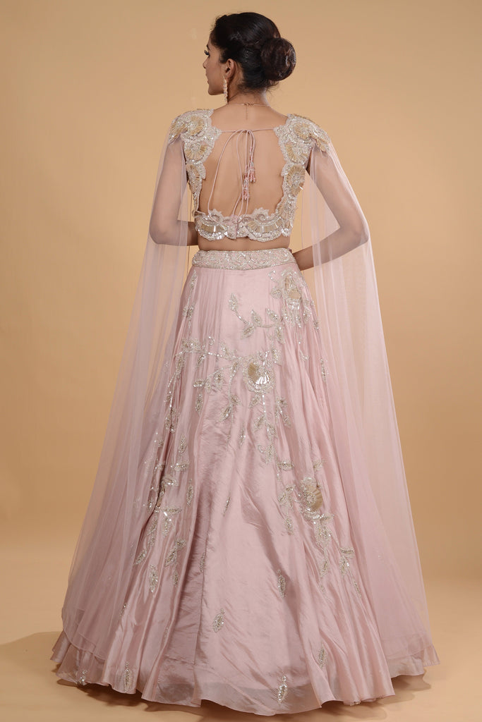 Blush pink crop top with cape and long skirt set.