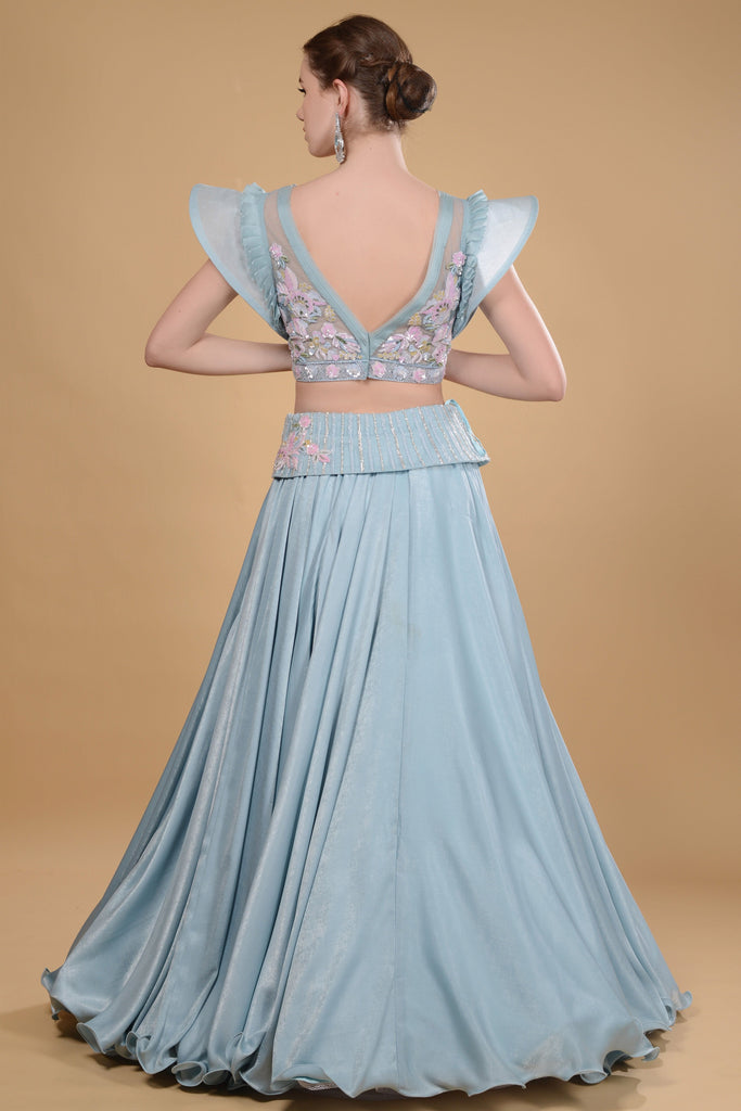 Light blue crop top and long skirt set.
