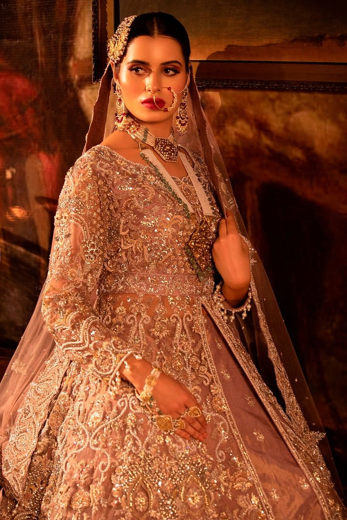 Dusty pink Trail Net Jacket Lehenga Set.