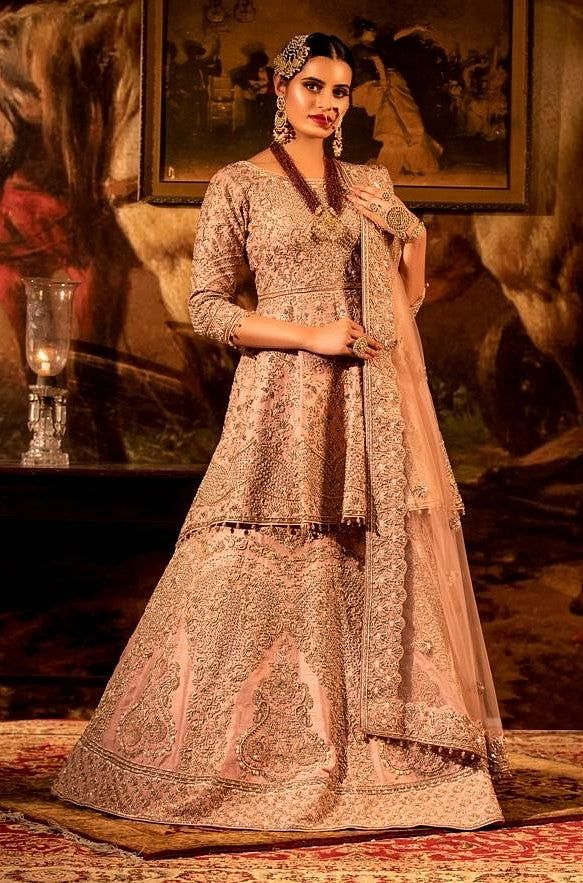 Dusty pink Peplum Lehenga set with Net dupatta.