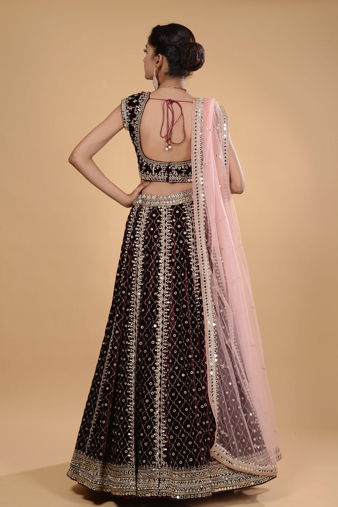 Wine and pink velvet lehenga set.