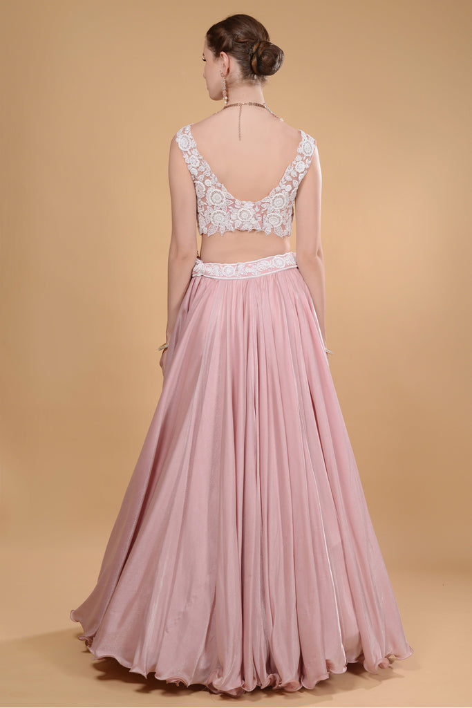 Blush pink crop top and long skirt.