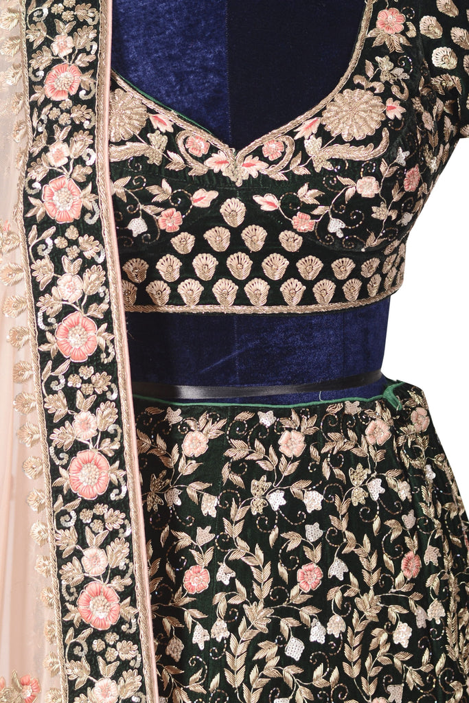 Dark green lehenga set.