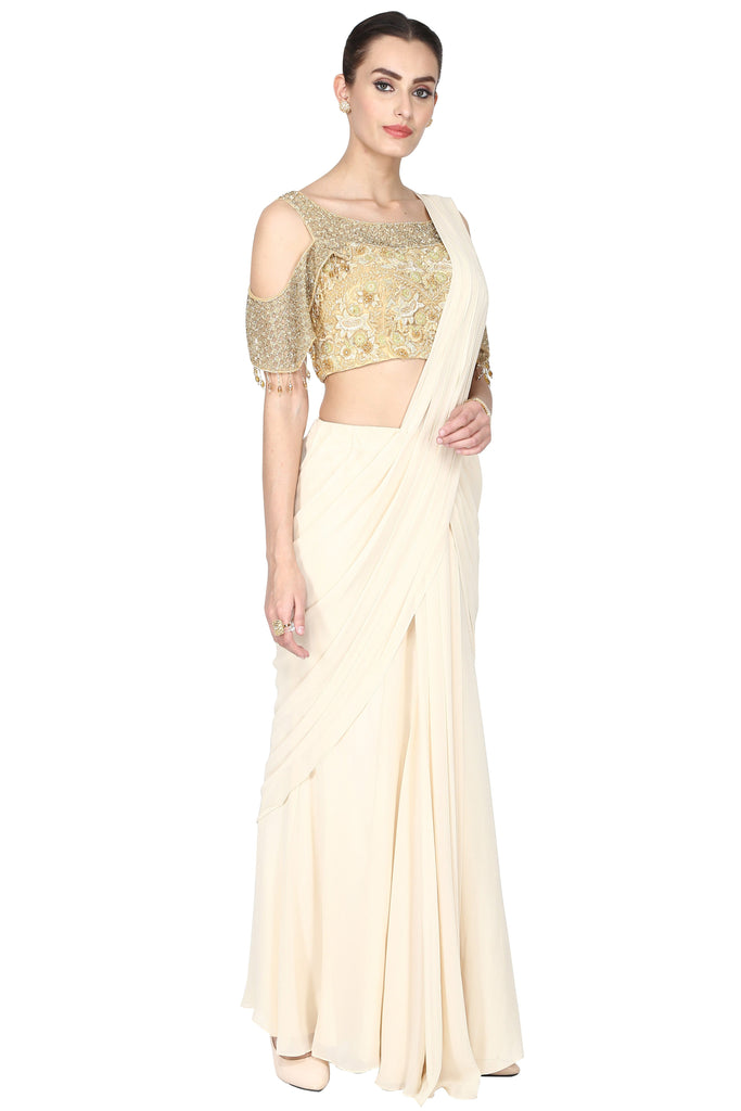 Off-white pre-drape saree with cold sleeves set.