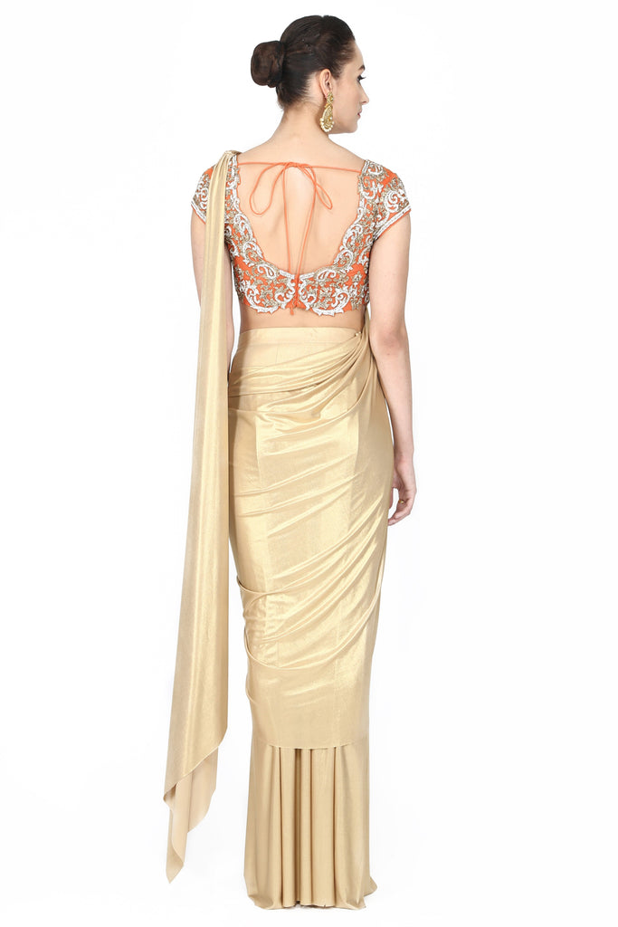 Metallic golden drape saree.