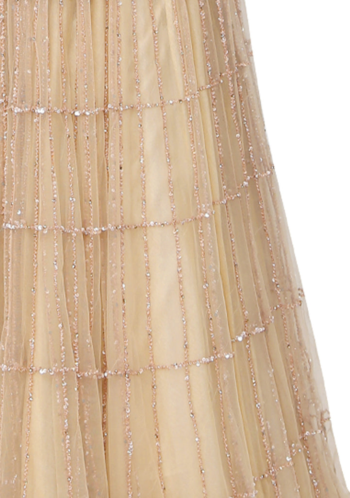 Nude symmetrical box embroidered gown.