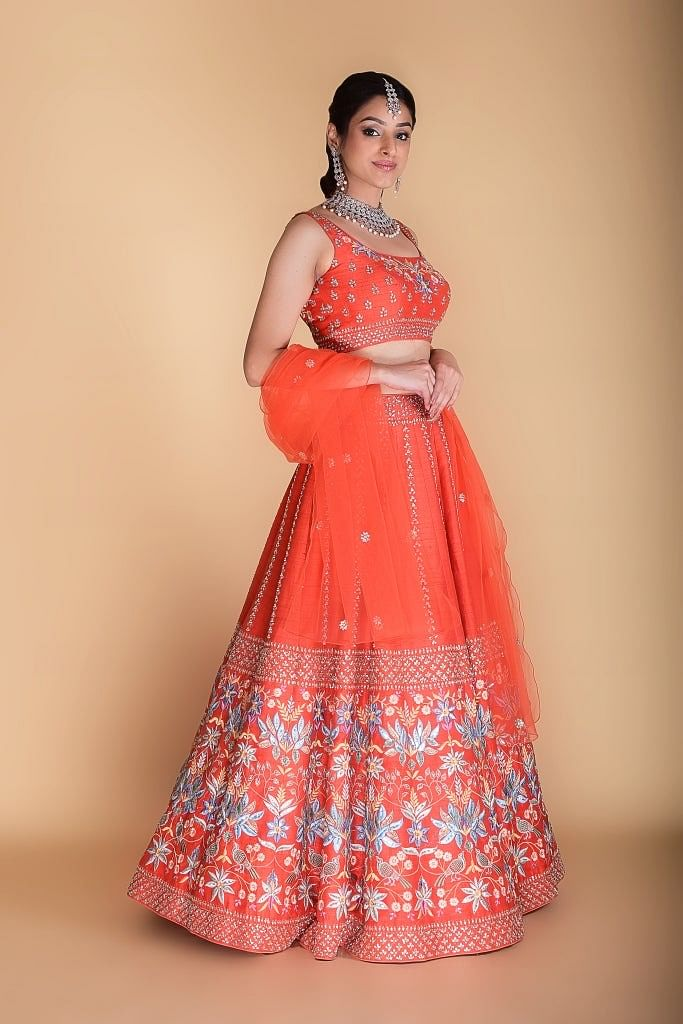 Bright Orange Embroidered Lehenga set.