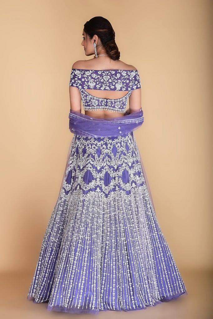 Light violet embroidered Lehenga set.