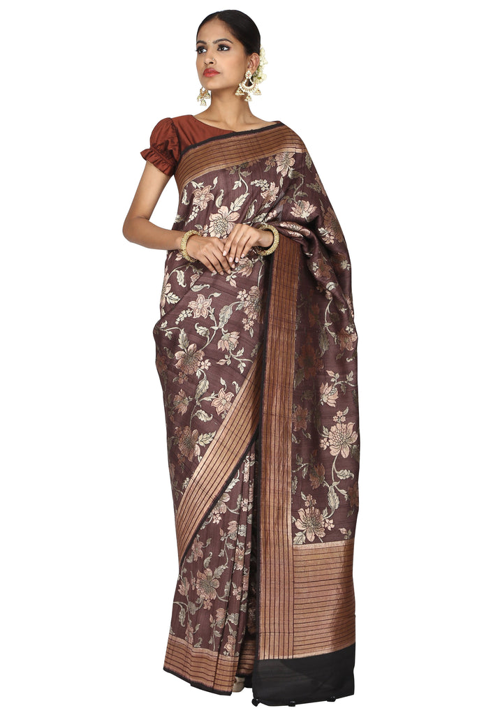 Cinnamon brown saree.