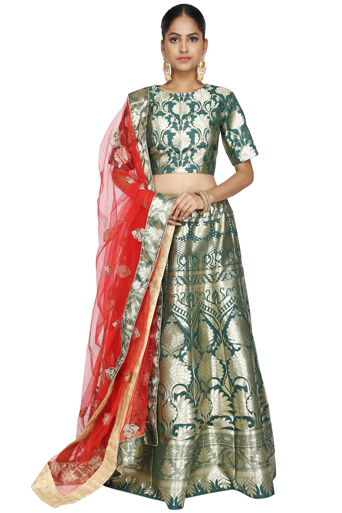 Dark green brocade lehenga set.