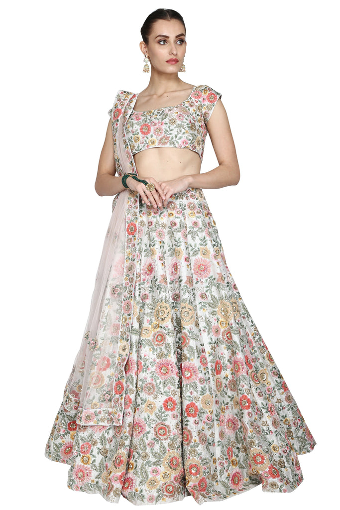 Pure White Embroidered lehenga set.