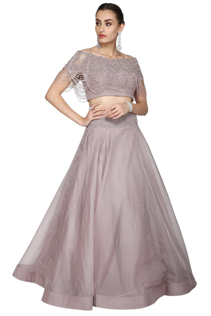 Dusty rose crop top and long skirt set.
