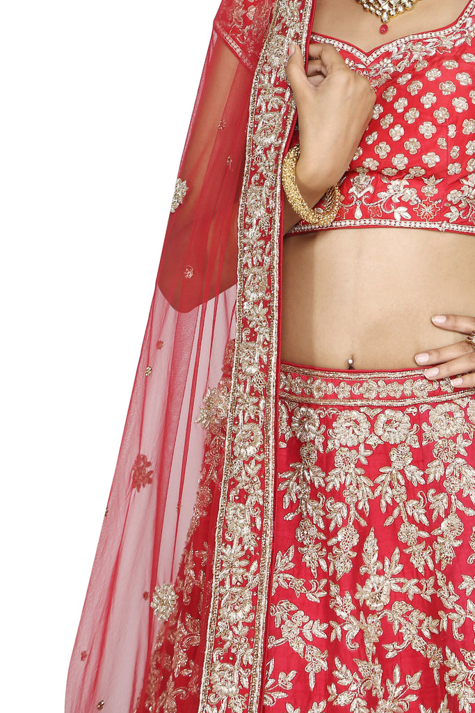 Rich red lehenga set.