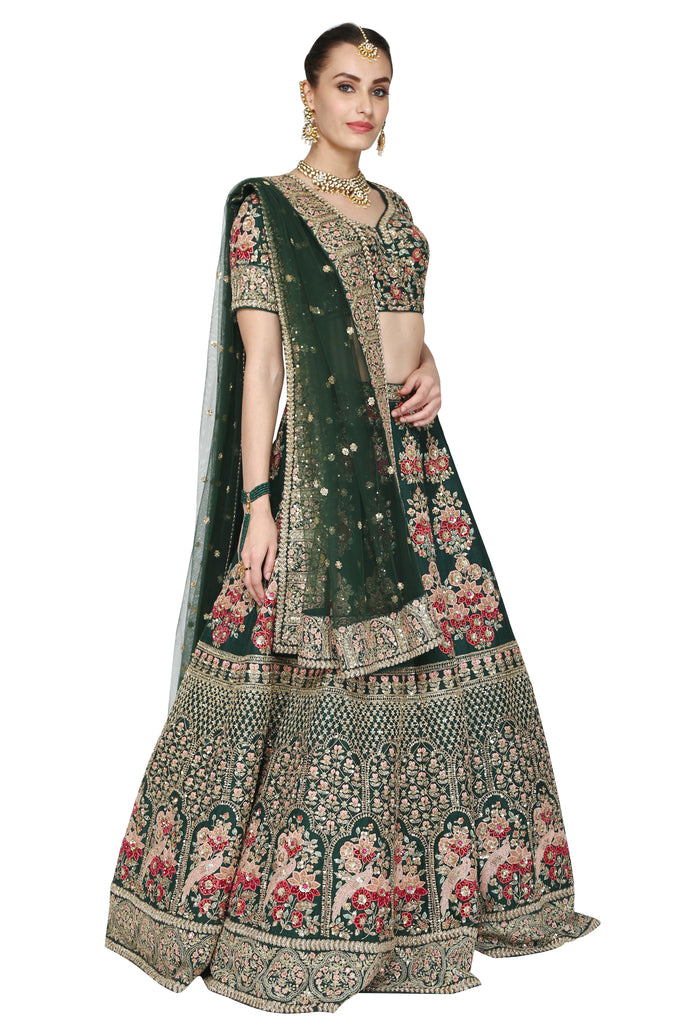 Emerald green lehenga set.