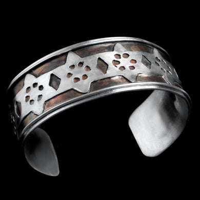 Sterling silver cuff with gold balls
