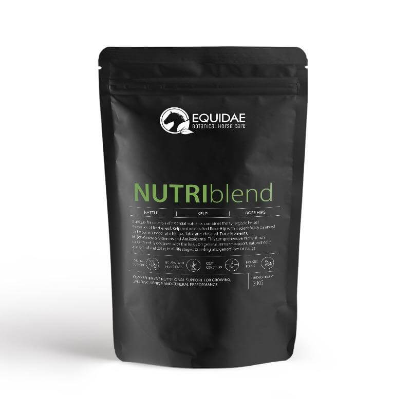 Large bag of NUTRIblend horse vitamin and mineral supplement being fed to horses to give them a shiny coat