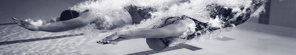 Two swimmers diving underwater into swimming pool contact page banner