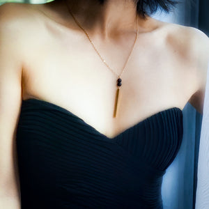 girl in strapless black dress wearing the Babe vertical bar essential oil ncklace