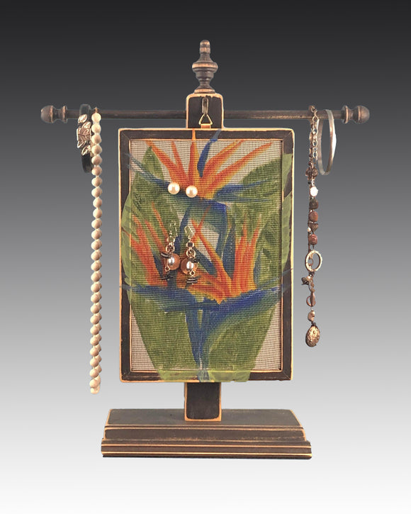 earring holder with bird of paradise design hanging on jewelry tree
