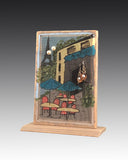 earring holder attached to a wood base with a bistro design