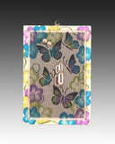 earring holder with a hand painted Butterflieseach design hanging on a jewelry tree