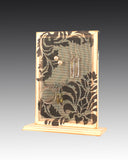 earring holder with a damask attached to a wood base