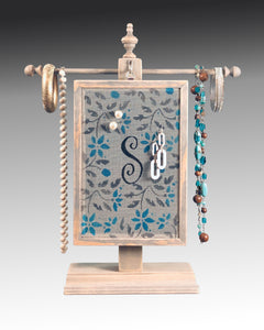 Monogram earring holder hanging on a necklace stand