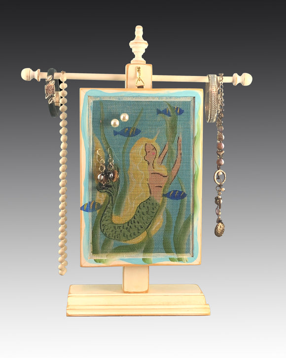 earring holder hanging on jewelry tree with mermaid design