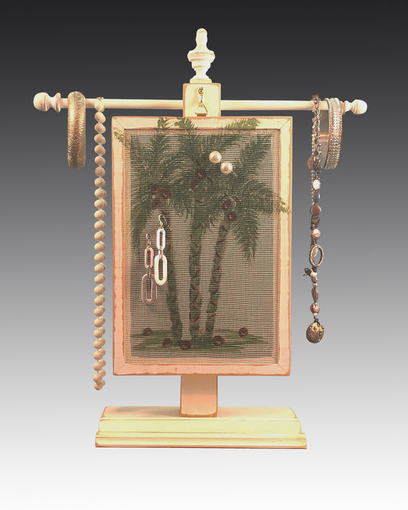 earring holder with palm design hanging on jewelry tree