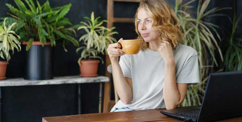 a woman drinking her coffee and relaxing during breaks