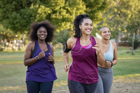 Three young women jogging in the park