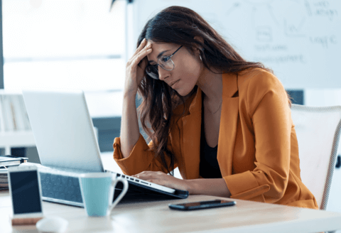 mental side effects of sleep deprivation - woman unable to focus at desk