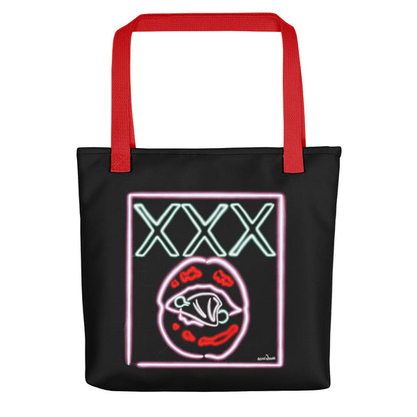 A tote bag with a red handle printed with a neon sign on a black baground featuring lips and the slogan XXX designed by Acid Nova.