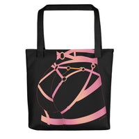A black tote bag featuring Acid Nova's Strappy Butt design. A black background with pink strappy lingerie worn on a pert bottom.