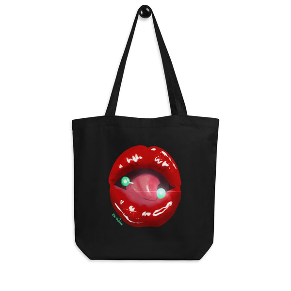 A black eco tote bag printed with Acid Nova's Lips design. A pierced tongue licks a juicy pair of bright red lips.